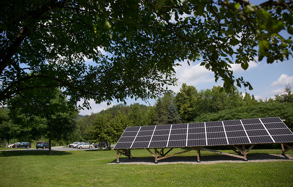 A commuter in a gas-powered SUV parks in the lot near Vermont Law School's seven electric vehicle charging stations in South Royalton, Vt., on July 12, 2017. There are plans to add more lower-powered charging stations at Vermont's only law school. (Photo by Geoff Hansen)