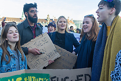 "Westminster, London, January 19th 2016. Students hold an ""emergency protest"" in Parliament Square and later blocking Westminster Bridge, against the cutting of maintenance grants. ""It took just 18 MPs 90 minutes to scrap maintenance grants for the million poorest students, without a debate in Parliament in a backroom committee"" PICTURED: Student chant ""No grants, no bridge as they stage a sit-in on Westminster Bridge. ///FOR LICENCING CONTACT: paul@pauldaveycreative.co.uk TEL:+44 (0) 7966 016 296 or +44 (0) 20 8969 6875. ©2015 Paul R Davey. All rights reserved."
