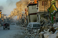 NaNou, a Haitian store in downtown Port-Au-Prince, burns in the distance along Jean Jacques Dessalines street after a devastating earthquake struck the caribbean nation killing an estimated 250,000 people in 2010.