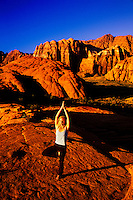 Woman doing yoga, Snow Canyon State Park, near Ivins, Utah