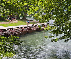 People enjoying Plitvice Lakes National Park, Croatia. A UNESCO World Heritage site, this natural wonder contains 16 lakes interconnected by rivers and streams. Known for its verdant foliage, numerous waterfalls, and different colored waters, this popular tourist attraction draws more than one million visitors annually.