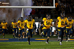 BERKELEY, CA - OCTOBER 06: The California Golden Bears enter the field before the game against the UCLA Bruins at California Memorial Stadium on October 6, 2012 in Berkeley, California. The California Golden Bears defeated the UCLA Bruins 43-17. (Photo by Jason O. Watson/Getty Images) *** Local Caption ***