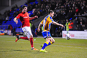Shaun Whalley of Shrewsbury Town clears from Chris Stokes of Coventry City FC during the Sky Bet League 1 match between Shrewsbury Town and Coventry City at Greenhous Meadow, Shrewsbury, England on 8 March 2016. Photo by Mike Sheridan.