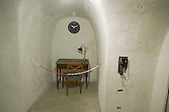 Roma 25 Ottobre 2014<br /> Aperti al pubblico i bunker segreti, costruiti tra il 1942 e il 1943,dove Benito  Mussolini e la sua famiglia cercava rifugio dai bombardamenti degli alleati nella residenza privata di Villa Torlonia. Nella foto: Il rifugio cantina, il prima ambiente adibito a rifugio antiaereo, attrezzato  intorno alla metà del 1940,  fu dotato di doppie porte blindate e di ,un sistema antigas di filtraggio, e rigenerazione dell'aria, che veniva azionato a manovella,  un gabinetto, un telefono con linea diretta ad uso di Mussolini. La scrivania messa a disposizione di Mussolini<br /> Open to the public the secret bunkers built between 1942 and 1943, where Benito Mussolini and his family sought refuge from Allied bombing in the private residence of Villa Torlonia. <br /> Pictured: The cellar shelter,  the first air-raid shelter,built around the middle of 1940, was equipped with double doors armored  and a gas filtering system and regeneration air , that was operated crank, a toilet, a direct dial telephone for use by Mussolini. The desk  to provision of Mussolini