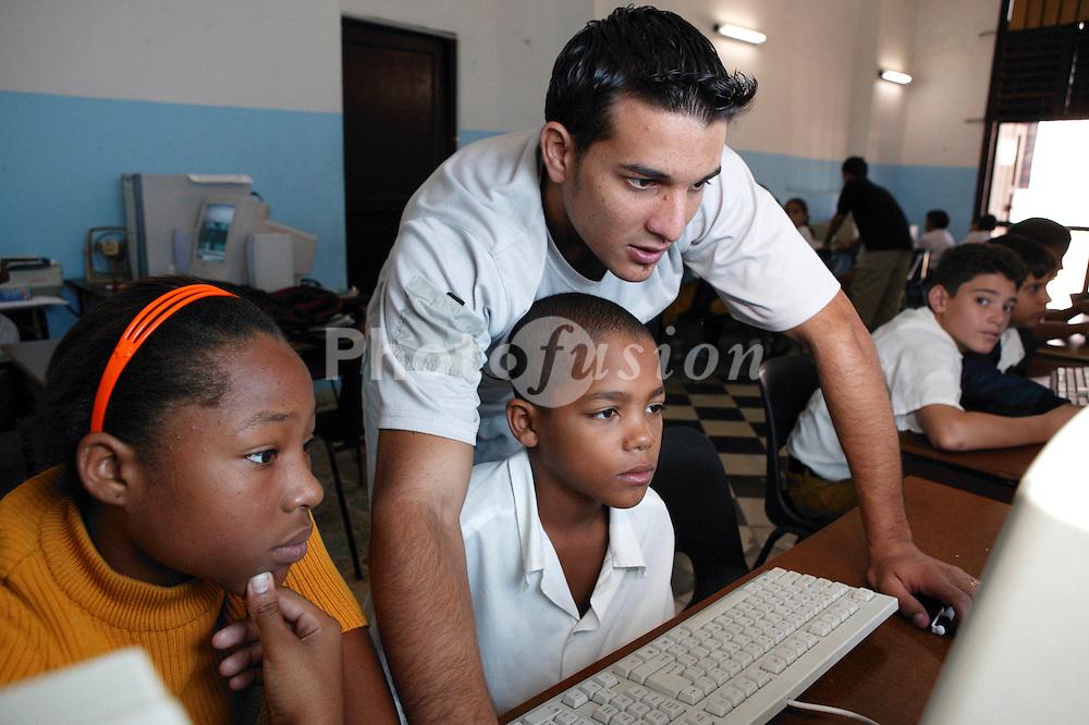 White male teacher in classroom at Carlos J Finlay secondary school; Havana; Cuba,