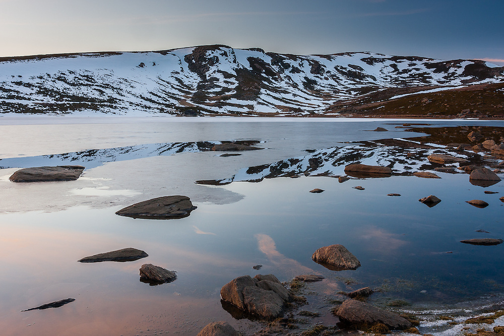 Reflections in the frozen surface of Laguna de Los Peces
