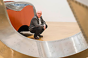 Tate Britain launches its major spring show, exhibiting the work of Turner Prize-winning artist Richard Deacon (b.1949 - pictured). It includes large sculptures made of twisted wood, metal, and ceramic such as: Fold 2012, a towering sculpture weighing over 12 tonnes and made of 60 shimmering glazed ceramic bricks; After 1998, a huge serpentine wooden structure that is over 9 metres at its longest point; Struck Dumb 1988  (pictured);  Mammoth 1989  (pictured foreground); and Out of Order 2003, a sprawling sculpture constructed from ribbons of steamed wood. The Tate Britain, London, UK 03 February 2014. Guy Bell, 07771 786236, guy@gbphotos.com