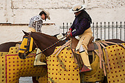 Mexican Picadors prepare to enter the bull ring for the bullfights at the Plaza de Toros in San Miguel de Allende, Mexico. Picadors ride horses surrounded by a peto, a mattress-like protection that greatly minimizes damage to the animal during the bullfight.