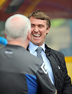 Picture by Graham Crowther/Focus Images Ltd. 07763140036.10/9/11 .Lee Clark manager of Huddersfield shares a joke with Lee Parry manager of Tranmere before the Npower League 1 game at the Galpharm Stadium, Huddersfield.