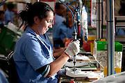Varginha_MG, Brasil...Trabalhadora em fabrica de reatores em Varginha, Minas Gerais..Worker in manufacturing reactors in Varginha, Minas Gerais..Foto: LEO DRUMOND / NITRO