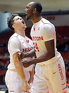 Jan 27, 2016; Houston, TX, USA;  Houston Cougars guard Rob Gray Jr. (2) and forward Devonta Pollard (24) reacts against the Tulsa Golden Hurricane  in the first half at Hofheinz Pavilion. Mandatory Credit: Thomas B. Shea-USA TODAY Sports