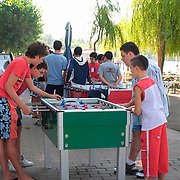 Teenagers playing foosball game at Lake Bolsena, Italy - no release available<br />