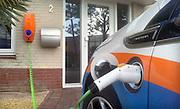Nederland, Malden, 4-10-2012Een Opel Ampera staat op te laden aan een laadpunt bij een woning.Foto: Flip Franssen/Hollandse Hoogte