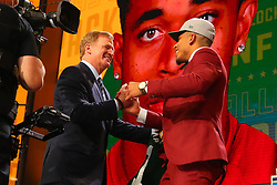 April 26, 2018 - Arlington, TX, U.S. - ARLINGTON, TX - APRIL 26:  Jaire Alexander shakes hands with NFL Commissioner Roger Goodell after being chosen by the Green Bay Packers with the 18th pick during the first round at the 2018 NFL Draft at AT&T Statium on April 26, 2018 at AT&T Stadium in Arlington Texas.  (Photo by Rich Graessle/Icon Sportswire) (Credit Image: © Rich Graessle/Icon SMI via ZUMA Press)