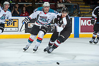 KELOWNA, CANADA - MARCH 21: Chance Braid #22 of Kelowna Rockets checks Thomas Foster #16 of Vancouver Giants on March 21, 2015 at Prospera Place in Kelowna, British Columbia, Canada.  (Photo by Marissa Baecker/Shoot the Breeze)  *** Local Caption *** Chance Braid; Thomas Foster;