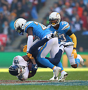 LONDON, ENGLAND - OCTOBER 21: wide receiver Tajae Sharpe (19) Of The Titans is tackled by defensive back Desmond King (20) of The Chargers during the NFL game between Tennessee Titans and Los Angeles Chargers at Wembley Stadium on October 21, 2018 in London, United Kingdom. (Photo by Mitchell Gunn/Pro Lens Photo Agency) *** Local Caption *** Tajae Sharpe; Desmond King