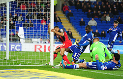 scrambles in the box as Bournemouth's Callum Wilson tries to push the ball over the line under pressure from Cardiff City's Bruno Ecuele Manga - Photo mandatory by-line: Alex James/JMP - Mobile: 07966 386802 - 17/03/2015 - SPORT - Football - Cardiff - Cardiff City Stadium - Cardiff City v AFC Bournemouth - Sky Bet Championship