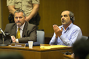 April 1, 2014 - El Cajon, California, U.S - <br /> <br /> Iraqi Immigrant Guilty In Wife's Murder<br /> <br /> 2014_Murder suspect Kassim Alhimidi reacts to being found guilty for the murder of his wife Shaima Alawadi. As the verdict was read the victim's mother and the defendant's son yelled in court and he was dragged from court. Defense attorney Richard Berkon sits at left. <br /> ©Exclusivepix