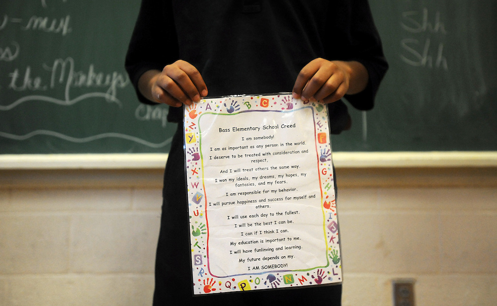 De'Aundre Wilson holds up the Bass Elementary School Creed.  Every morning the entire student body reads the creed together which focuses on their potential, abilities and unique character traits.