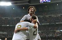 FUSSBALL   CHAMPIONS LEAGUE   SAISON 2011/2012  Achtelfinale Rueckspiel 14.03.2012 Real Madrid  - ZSKA Moskau  JUBEL Real Madrid; Kaka (unten li) mit Gonzalo Higuain (unten re) umarmt von Marcelo (oben, Real Madrid)