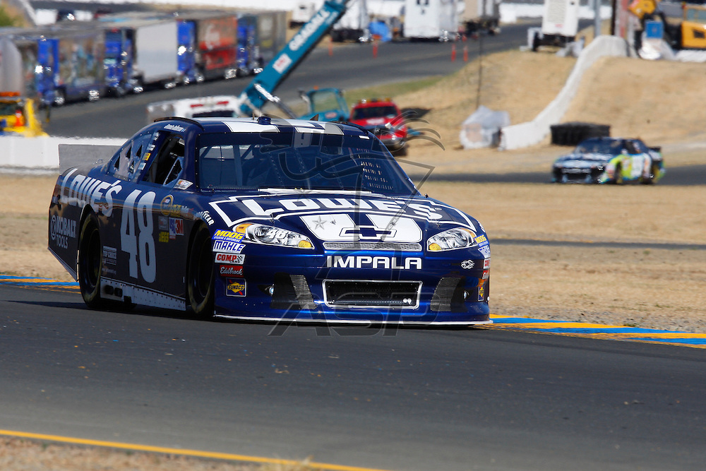 SONOMA, CA - JUN 23, 2012:  Jimmie Johnson (48) brings his car through turn 10 during a practice session for the Toyota Save Mart 350 at the Raceway at Sonoma in Sonoma, CA.