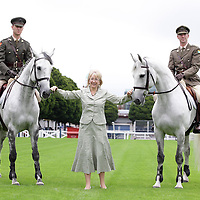 Tourism Minister Mary Hanafin  with Capt David O'Bryne and Capt David Power members of the Army Equitation school at the launch of the Failte Ireland Dublin Horse Show at the RDS in Dublin.<br /> Marc O'Sullivan