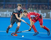 BHUBANESWAR, INDIA - Seve van Ass (Ned) met Nicolas de Kerpel (Belgie)    tijdens de  finale tussen België en Nederland bij het WK Hockey heren in het Kalinga Stadion. COPYRIGHT KOEN SUYK