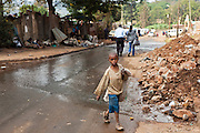 A street child collecting plastic and metal for recycling on the streets of Thika, Kenya.