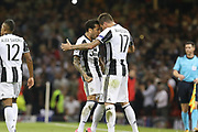 Juventus Defender Daniel Alves congratsulates Juventus Forward Mario Mandzukic after his goal 1-1 during the Champions League Final between Juventus and Real Madrid at the National Stadium of Wales, Cardiff, Wales on 3 June 2017. Photo by Phil Duncan.