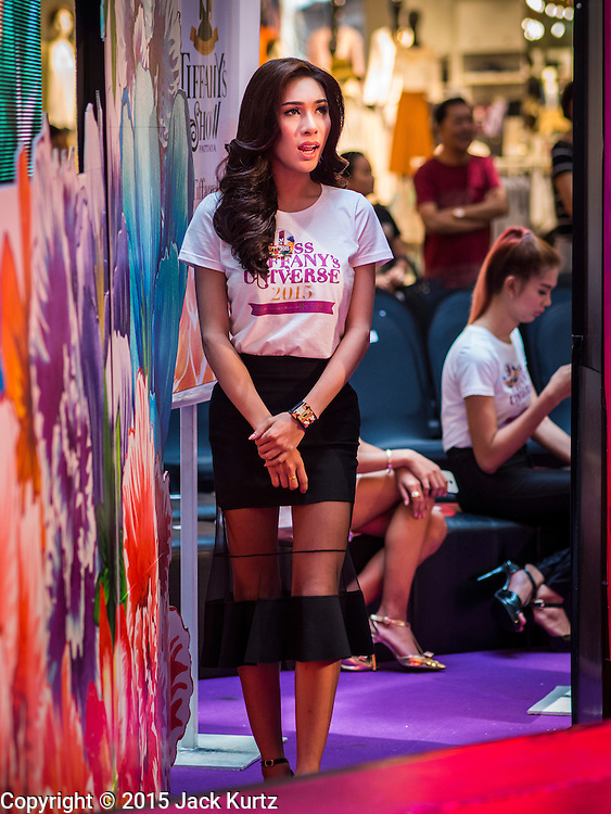 25 MARCH 2015 - BANGKOK, THAILAND: A contestant waits to walk across the stage in the first round of the Miss Tiffany's contest at CentralWorld, a large shopping mall in Bangkok. Miss Tiffany's Universe is a beauty contest for transgender contestants; all of the contestants were born biologically male. The final round will be held on May 8 in the beach resort of Pattaya. The final round is televised of the  Miss Tiffany's Universe contest is broadcast live on Thai television with an average of 15 million viewers.     PHOTO BY JACK KURTZ