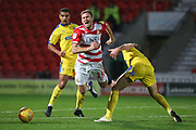 Doncaster midfielder Herbie Kane and AFC Wimbledon midfielder Scott Wagstaff during the EFL Sky Bet League 1 match between Doncaster Rovers and AFC Wimbledon at the Keepmoat Stadium, Doncaster, England on 17 November 2018.