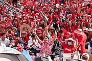 """Apr 4, 2010 - BANGKOK, THAILAND: Red Shirt protestors in Ratchaprasong intersection. Thousands of members of the United Front of Democracy Against Dictatorship (UDD), also known as the """"Red Shirts"""" and their supporters moved their anti government protests into central Bangkok Apr. 4 when they occupied Ratchaprasong intersection, the site of Bangkok's fanciest shopping malls and several 5 star hotels. The Red Shirts are demanding the resignation of current Thai Prime Minister Abhisit Vejjajiva and his government. The protest is a continuation of protests the Red Shirts have been holding across Thailand. They support former Prime Minister Thaksin Shinawatra, who was deposed in a coup in 2006 and went into exile rather than go to prison after being convicted on corruption charges. Thaksin is still enormously popular in rural Thailand. This move, away from their traditional protest site in the old part of Bangkok, has gridlocked the center of the city and closed hundreds of stores and restaurants and several religious shrines. There has not been any violence, but the government had demanded that the Red Shirts return to the old part of the city.   PHOTO BY JACK KURTZ"""