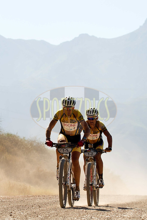 Christoph Sauser and Burry Stander of Team 36ONE-SONGO-SPECIALIZED increase their lead during stage 1 of the 2012 Absa Cape Epic Mountain Bike stage race held from Robertson Primary School in Robertson, South Africa on the 26 March 2012..Photo by Greg Beadle/Cape Epic/SPORTZPICS
