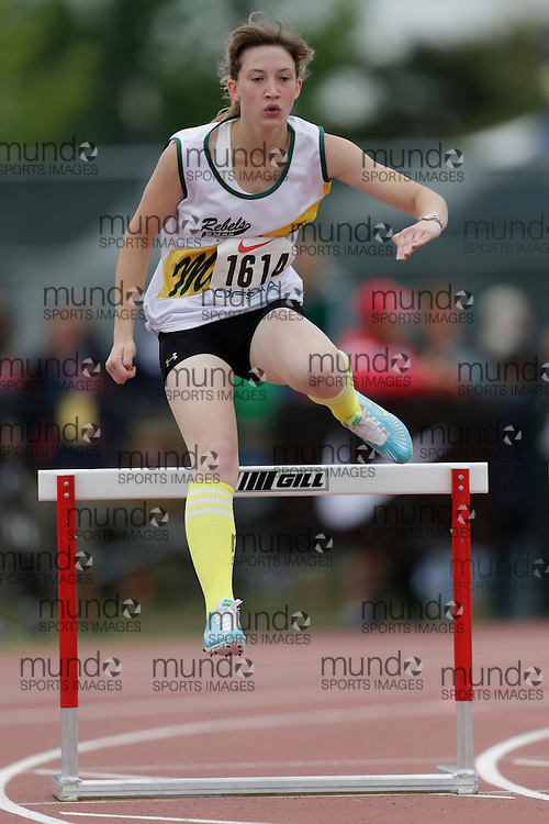 Rachel Woolhead of Roland Michener SS -S Porcupin competes in the intermediate hurdle heats at the 2013 OFSAA Track and Field Championship in Oshawa Ontario, Saturday,  June 8, 2013.<br /> Mundo Sport Images/ Geoff Robins