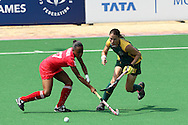 Brittney Hingh and Kim Hubach during the women's hockey match of the The Commonwealth Games between South Africa and Trinidad and Tobago held at the Stadium in New Delhi, India on the  October 2010..Photo by:  Ron Gaunt/SPORTZPICS/PHOTOSPORT