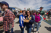 Nevaeh and Wanda Rodriguez share some loaded tator tots from Kimberly's Kitchen while waiting in line for some jambalaya from Chef Koz's Food Truck during the Exit 20 Food Truck Festival on Saturday at the Tanger Outlets in Tilton.  (Karen Bobotas/for the Laconia Daily Sun)