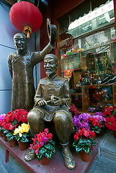 Ornate bronze sculptures outside traditional shoe shop in central Beijing China