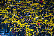 BSC Young Boys fans put on a display with their scarves during the Europa League Group G match between Rangers FC and BSC Young Boys at Ibrox Park, Glasgow, Scotland on 12 December 2019.
