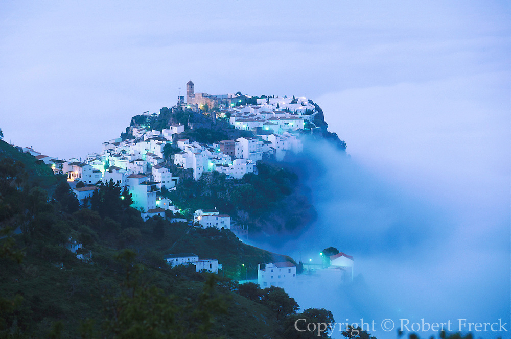 SPAIN, ANDALUSIA CASARES; a picturesque mountain village or 'pueblo blanco' near Estepona on the Costa del Sol; seen in early morning mist