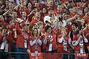 Fans of the Ohio State Buckeyes cheer for their team during the College Football Playoff National Championship Game against the Oregon Ducks at AT&T Stadium on January 12, 2015 in Arlington, Texas.  (Cooper Neill for The New York Times)