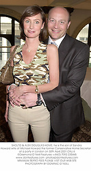 SHOLTO & ALEX DOUGLAS-HOME, he is the son of Sandra Howard wife of Michael Howard the former Conservative Home Secretary, at a party in London on 30th April 2001.	ONJ 6