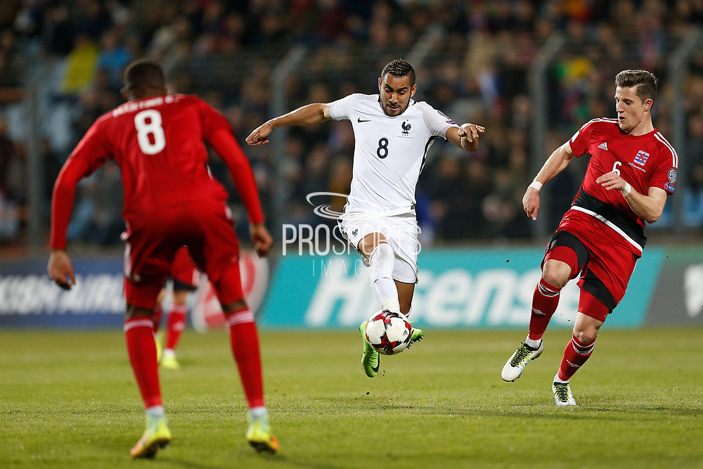 France's forward Dimitri Payet runs with the ball during the FIFA World Cup 2018 qualifying football match, Group A, between Luxembourg and France on March 25, 2017 at Josy Barthel stadium in Luxembourg - Photo Benjamin Cremel / ProSportsImages / DPPI
