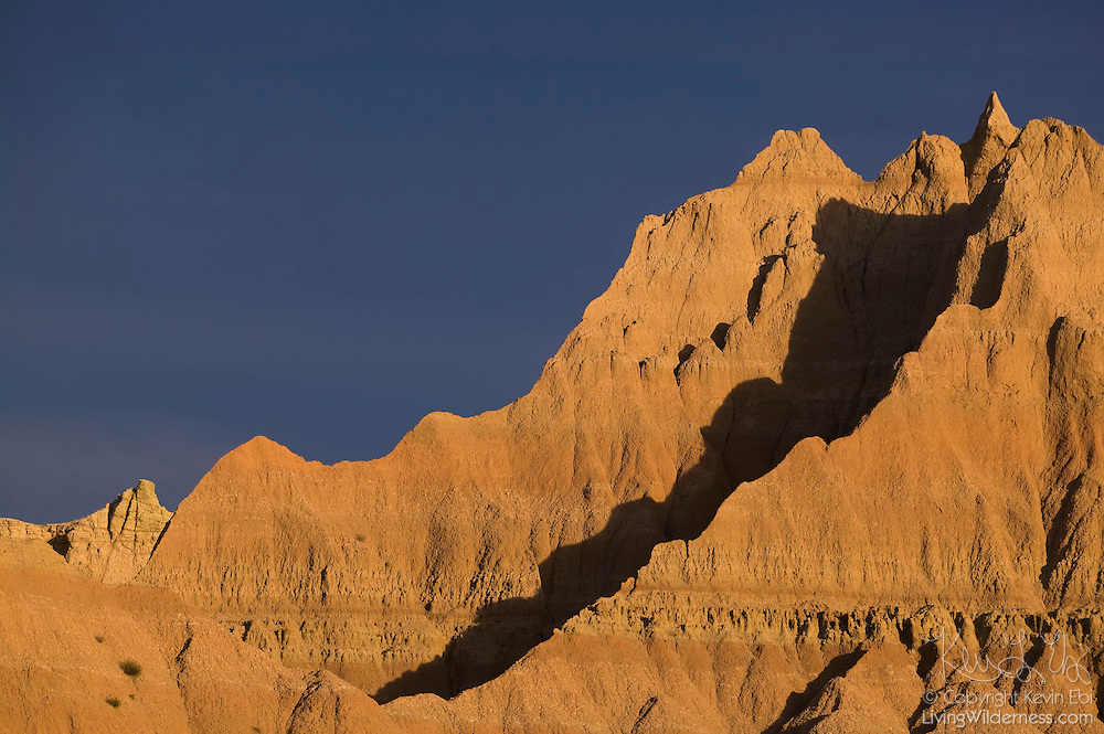 The setting sun lights up several of the large sandstone fins that make up Badlands National Park in South Dakota.