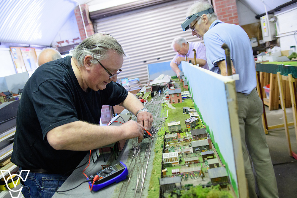 INSIGHT MAGAZINE: Bridlington Model Railway Society are based in Station Road, Bridlington, in a railway arch unit owned by Network Rail.  Pictured is Graham Wilson working on the model of Filey Station.<br /> <br /> Picture: Chris Vaughan Photography<br /> Date: May 31, 2017