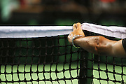 Tennis concept official inspects the net