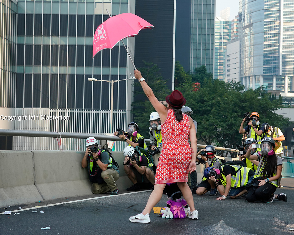 Hong Kong. 1 October 2019. After a peaceful march through Hong Kong Island by an estimated 100,000 pro democracy supporters, violent flared up at Tamar, Admiralty and moved through Wanchai district. Police used teargas and baton rounds and water cannon. Hard core group lit fires, threw bricks and Molotov cocktails at police. Violence continues into evening. Female shouting at police to stop violence at Tamar. Iain Masterton/Alamy Live News.