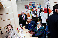 ROME, ITALY - 21 APRIL 2013: Customers of a cafe watch supporters of the Five-Star Movement gathering in Piazza Santi Apostoli for a rally and ready to march towards the Colosseum the day after the re-election of President Giorgio Napolitano,  in Rome, Italy, on April 21, 2013.<br /> <br /> Italy's lawmakers re-elected 87-year-old President Giorgio Napolitano on Saturday in a bid to break the country's political gridlock, as protestors outside parliament protested agains the result. Giorgio Napolitano won with a  majority of 738 ballots out of 1,007 possible votes, ahead of leftist academic Stefano Rodota, backed by the the anti-establishment Five Star Movement, who scored 217.