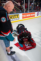 KELOWNA, CANADA - MARCH 16:  Roman Basran #30 of the Kelowna Rockets autographs his spiderman jersey for the winner on March 16, 2019 at Prospera Place in Kelowna, British Columbia, Canada.  (Photo by Marissa Baecker/Shoot the Breeze)