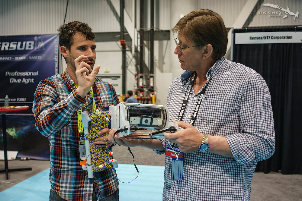 I bumped into Eric Stackpole with OpenROV. He's showing Peter Mooney the unit.
