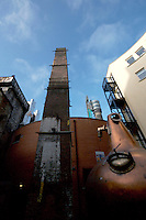 Whiskey still and chimney outside the Old Jameson Distillery Smithfield  Dublin Ireland